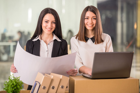 new office space: Two adult businesswomen planning out their new office space. Stock Photo