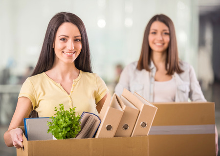 Two female entrepreneurs moving into a new office photo