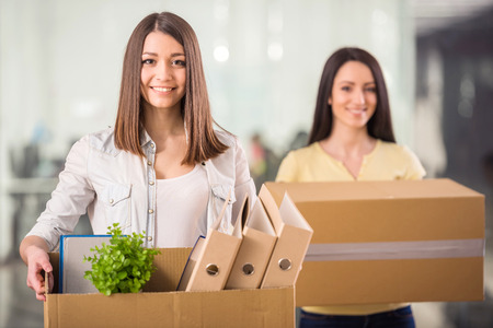 Two female entrepreneurs moving into a new office Stock Photo - 38868492
