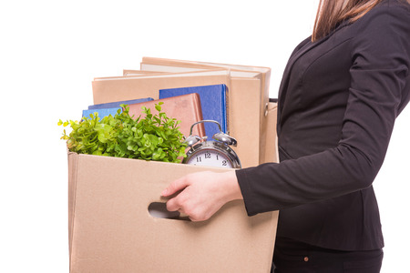 employee: Side view. Business woman holding box with office items.