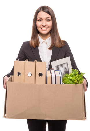 belongings: Business woman holding box with office items.  Stock Photo