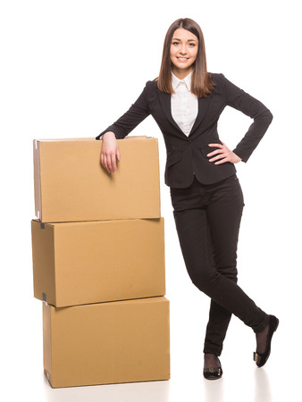 moving office: Businesswoman packing in carton boxes and getting ready for moving - isolated on white . Stock Photo