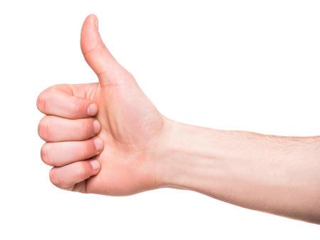 男性の手のクローズ アップは、白い背景の上の親指を署名を見せています。