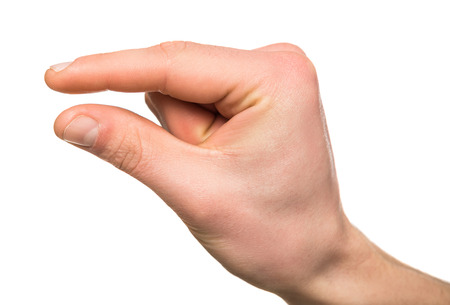 Man's hand gesturing a small amount, isolated on white.