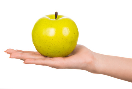 Womans hand with an apple isolated on white background. photo