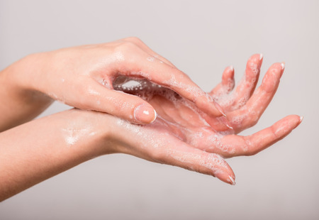 disinfect: A woman washing her hands with a soap suds. Stock Photo
