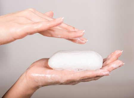 A woman washing her hands with a soap. photo