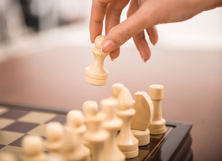 Image of female hand is playing chess. photo
