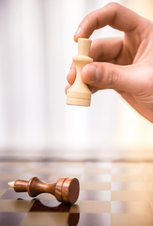 Image of male hand is playing chess. photo