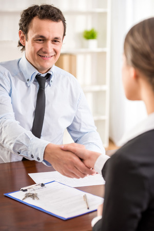 Handshake of a real estate agent and a client. Stock Photo