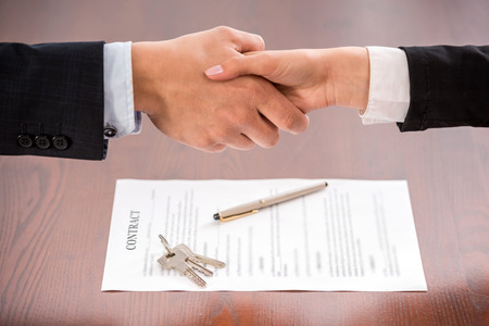 key handover: Handshake of a real estate agent and a client. Stock Photo