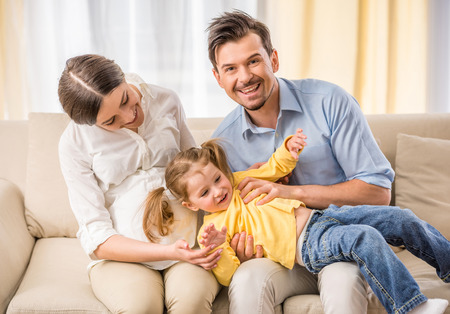 3 year old: Happy family spend time together at home.