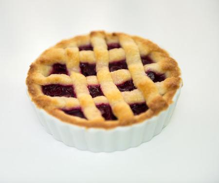 sweet tart: Sweet tart cake stuffed with berry jam on white background.