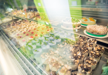 Pastry shop display window with variety of  tasty desserts. Stock Photo