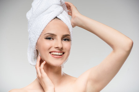 towel head: Portrait of beautiful young woman with towel on head.