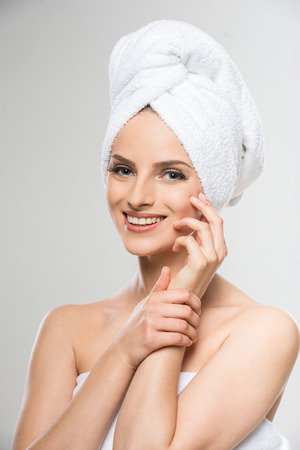 towel head: Beautiful young woman with a towel on her head after bath.