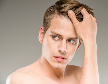 nude male body: Beauty concept. Handsome man with naked torso looking away. Stock Photo