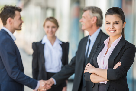 business hands: Meeting of business people. Two confident business men shaking hands.
