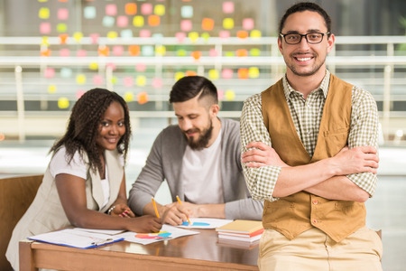 coworkers: Young talented colleagues search new ideas at the meeting. Stock Photo