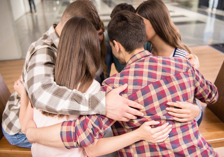 trust people: Circle of trust. Group of people sitting in circle and supporting each other.