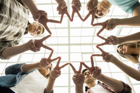 trust business: Circle of trust. Group of people sitting in circle and supporting each other.