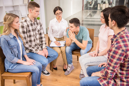 Therapist speaking to a rehab group at therapy session. Stock Photo