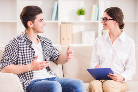 counseling session: Psychologist having session with her patient in her private consulting room.