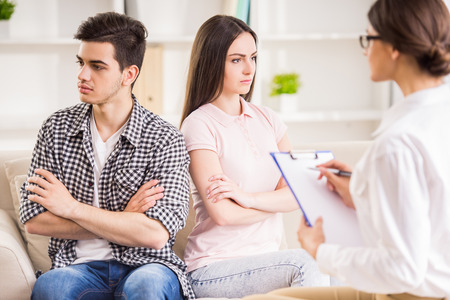 relationship difficulties: Young couple with relationship difficulties during therapy session.