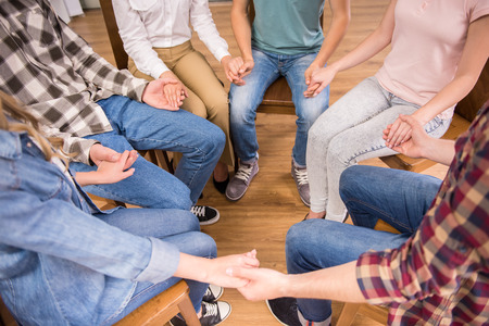 round chairs: Circle of trust. Group of people sitting in circle and supporting each other.