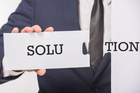 affirmations: Business man holding paper fragments with message text written on it. Close-up. Stock Photo
