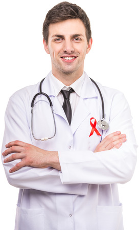 aids symbol: Handsome male doctor with red ribbon as a symbol of AIDS on white background.