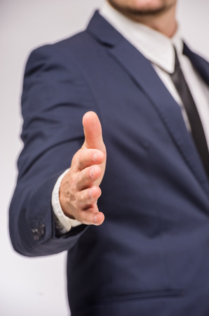 open palm: Close-up of business man holding open palm to greet somebody.
