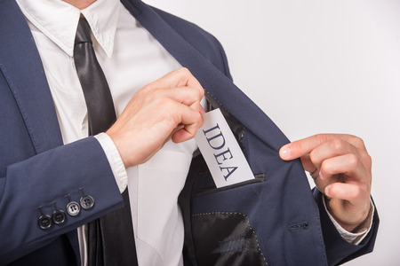 affirmations: Business man holding a card with message text written on it. Close-up.