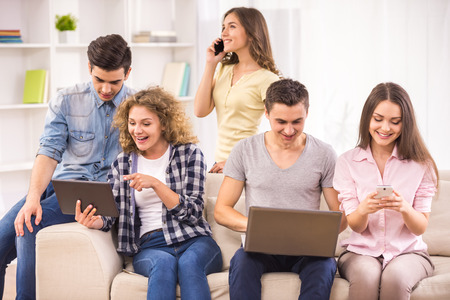 common room: Group of college students having fun at common room. Stock Photo