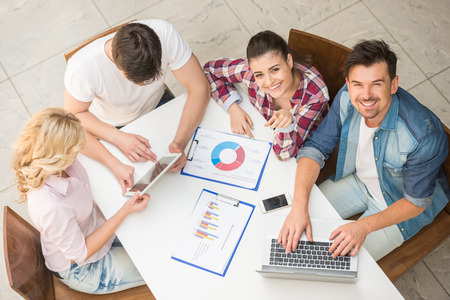 Group of young creative people sitting at office and brainstormimg. Stock Photo
