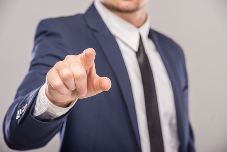 Business man pointing the finger at you, isolated on white background Standard-Bild