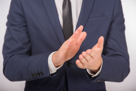 somebody: Close-up of business man clapping to somebody. Business success concept. Stock Photo
