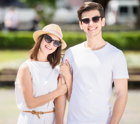 nifty: Young nifty couple walking along the street on summer day. Stock Photo