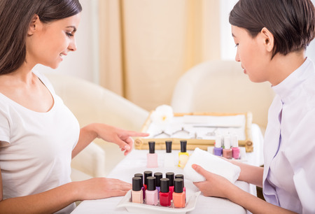 doing business: Beautiful girl in a beauty salon. Manicure in process. Spa treatment.