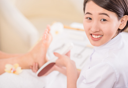 podiatry: Peeling feet pedicure procedure in a beauty salon.
