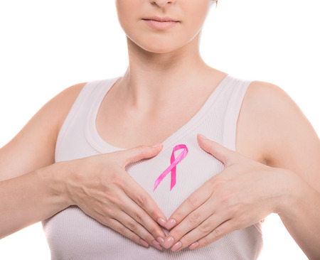 fighting cancer: Close-up of woman with pink breast cancer awareness ribbon fighting over white background. Stock Photo