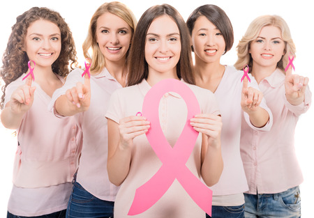 Confident female volunteers participating in breast cancer awareness.