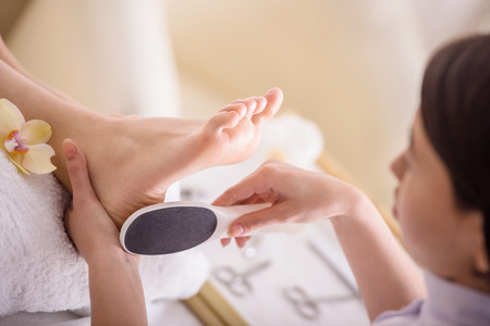 manicure and pedicure: Peeling feet pedicure procedure in a beauty salon.
