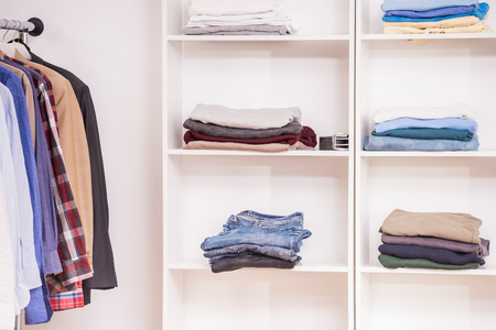 ironed: Clean and ironed mens clothing is in the white wardrobe.