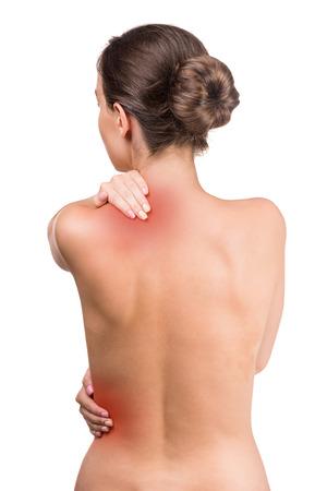 mujer desnuda de espalda: Mujer desnuda con dolor en el cuello y la espalda en el fondo blanco. Vista trasera.