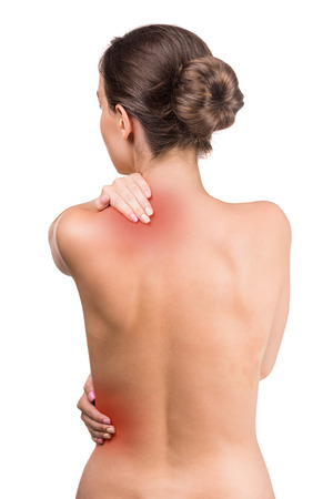 nude back: Naked woman with pain in neck and back on white background. Back view. Stock Photo