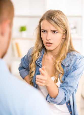 stressed woman: Young woman accusing her husband. Troubles in relations.