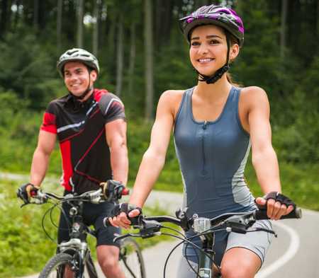 cycling mountain: Happy carefree bike couple cycling outdoors and leading healthy lifestyle.