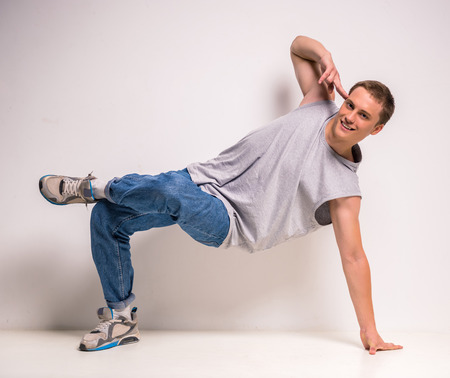 breakdancer: Attractive young breakdancer showing his skills on white background. Stock Photo