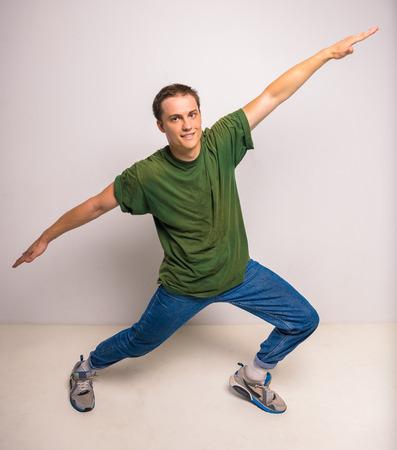 breakdancer: Handsome breakdancer standing at studio on white background.